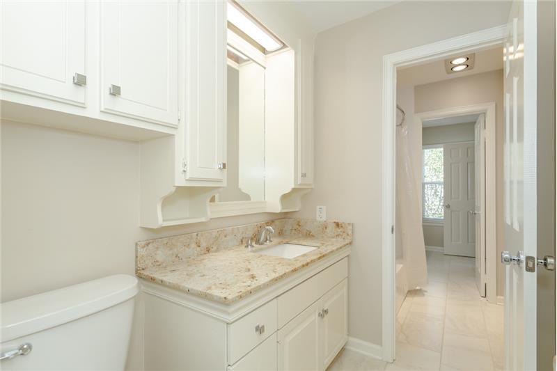 One of two half bathrooms off each bedroom