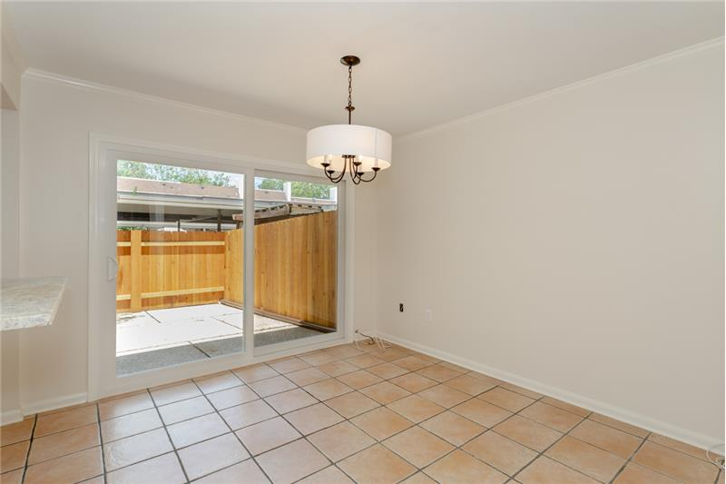 Dining Room with new sliding glass door and fixture