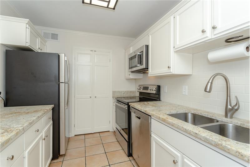 Kitchen has all new appliances including refrigerator