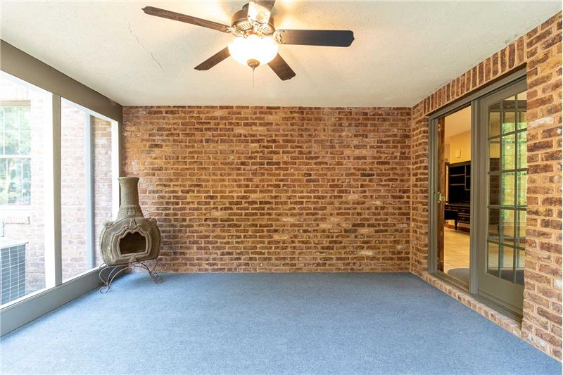 Screened in porch with ceiling fan