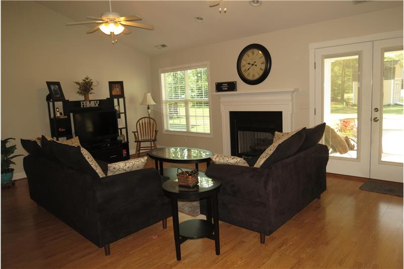 Laminate floors and gas logs fireplace