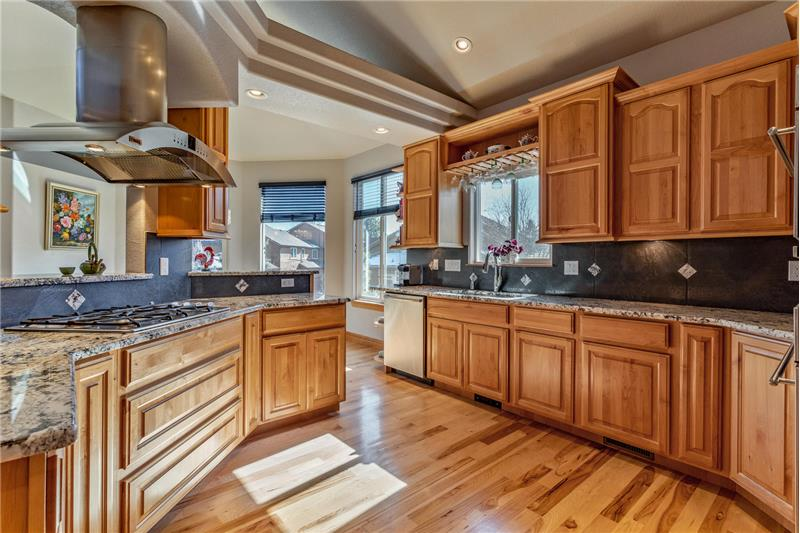 Kitchen has high-end appliances including gas cooktop and GE Monogram hood