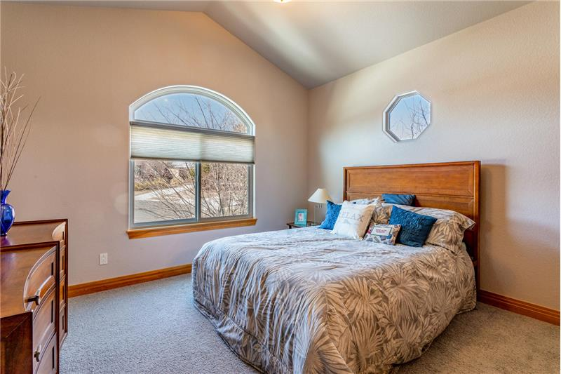 Guest bedroom has vaulted ceiling too!
