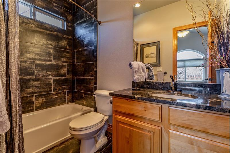 Guest bedroom has an en suite full bath