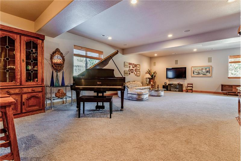 View of basement family room from wet bar