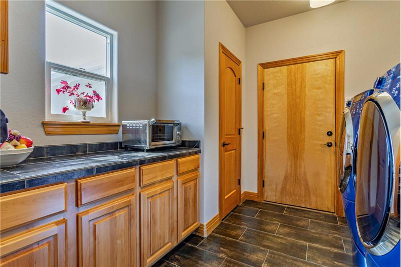 Laundry room serves as mudroom to garage. High efficiency washer & dryer on pedestals are included