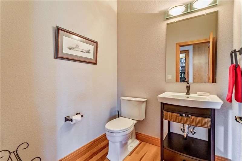Powder room is between formal dining room and kitchen