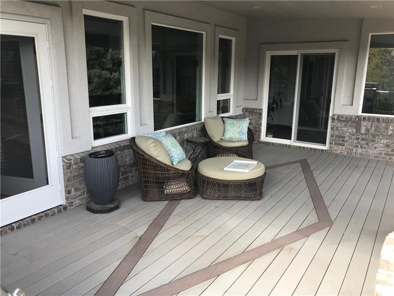 The covered deck outside the living room (left) and master suite (right) features an attractive design in the Trex decking.