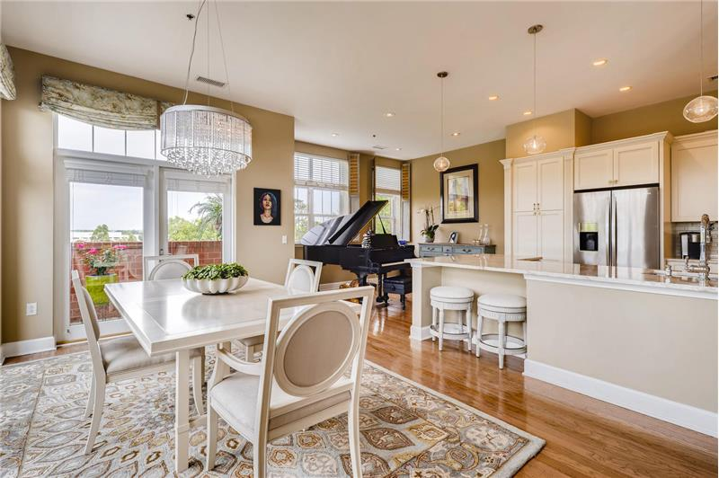 Open sight lines to kitchen and den; chic designer chandelier adds sophistication.