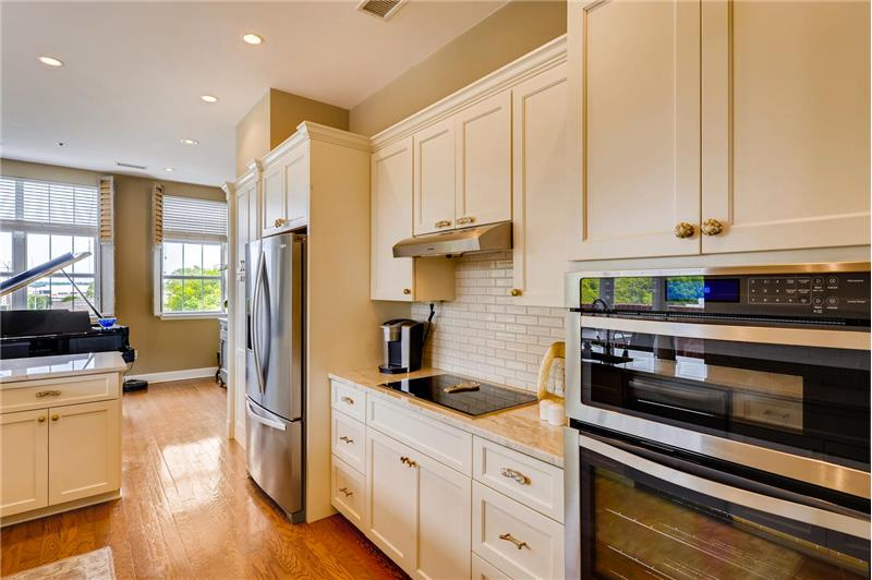 Recessed lights installed throughout the kitchen and den.