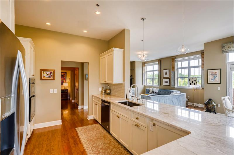 Kitchwn fully renovated in 2017 with custom, soft-close cabinets, designer pendant lights.