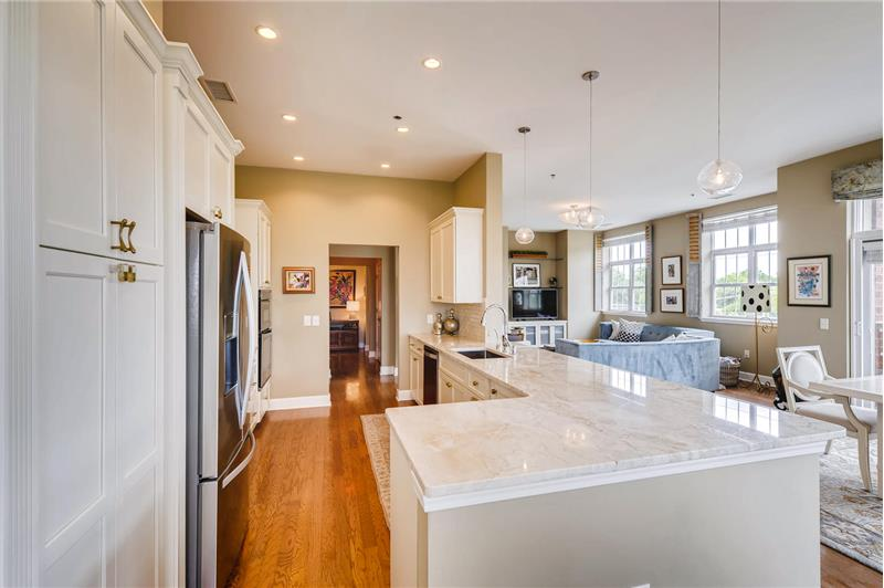 Ample cabinet and counter space. Open sight lines to the living and dining areas.