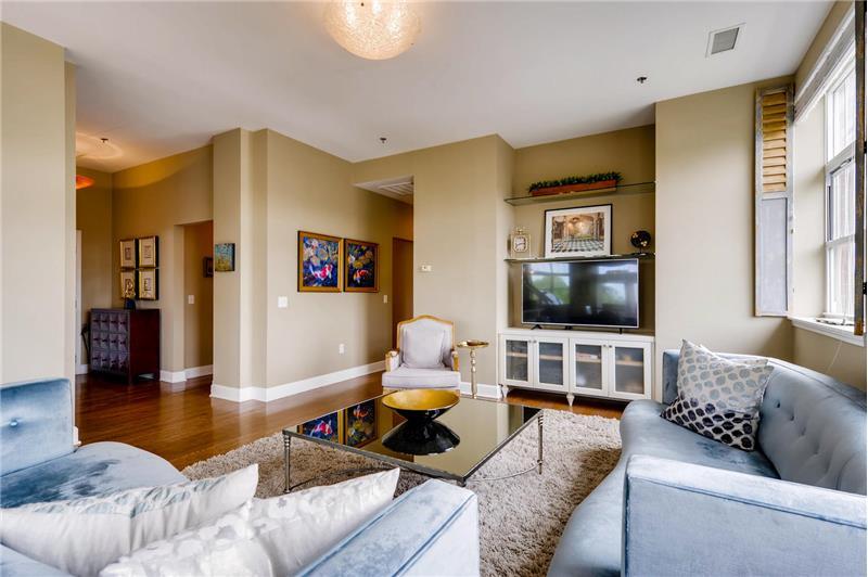 Open to the foyer; custom-built cabinet for AV equipment, surround sound.