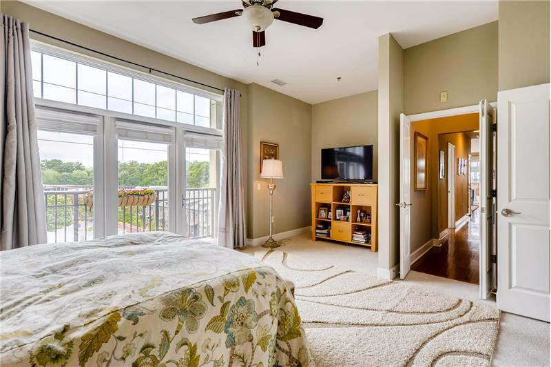 Room for a cozy sitting sitting area. Features surround sound, ceiling fan with light, double-door entry.