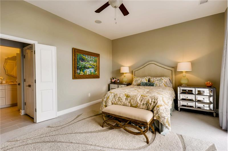 Space for a king-sized bed; walk-in custom closet, large linen closet, double door entry to en-suite bath.