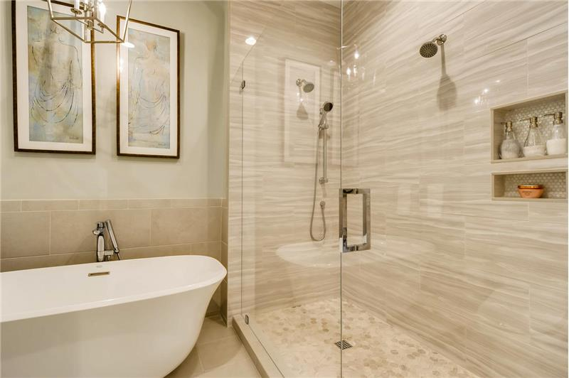 Fully remodeled in 2017, luxurious, spa-like tiled shower with three shower heads, seamless glass shower door.