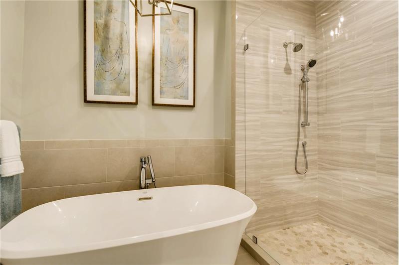 Jacuzzi brand, stand-alone soaking tub! Plus new toilet/bidet.