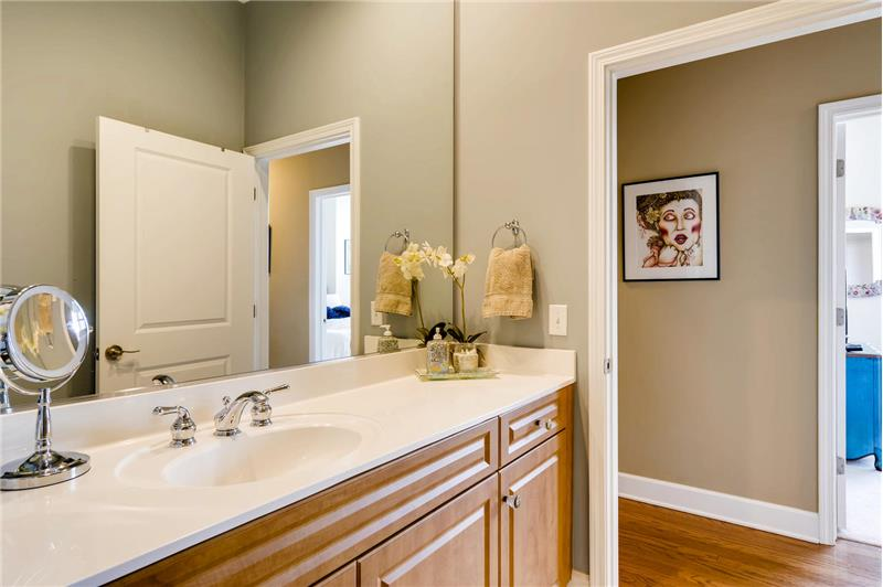 Spacious bathroom situated across the hall from the guest bedroom.