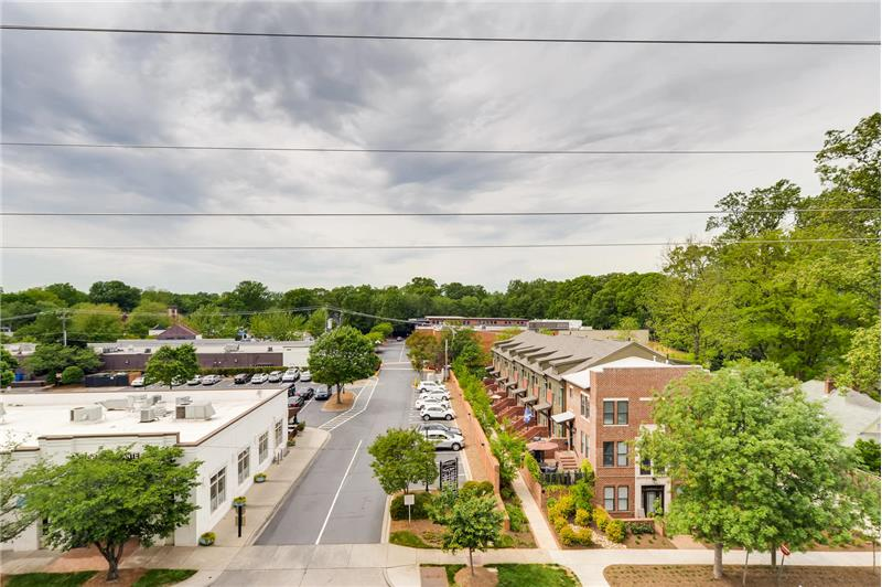 Street views from from balcony. Walking distance to numerous shopping and dining options.
