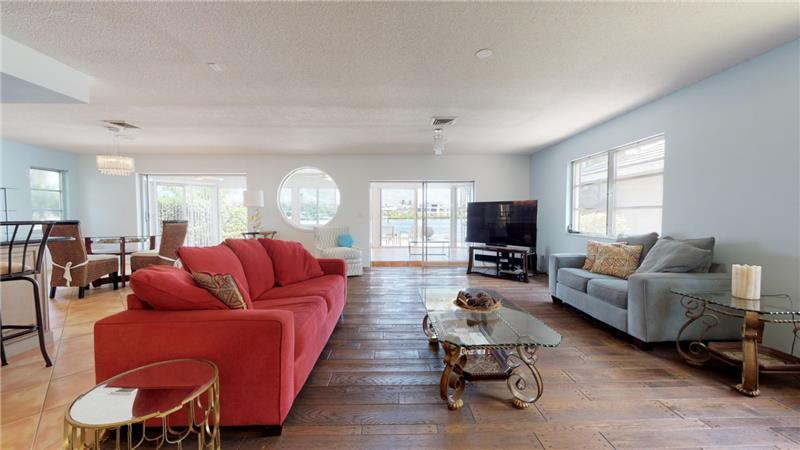 Living Room opens to Lanai and Bay