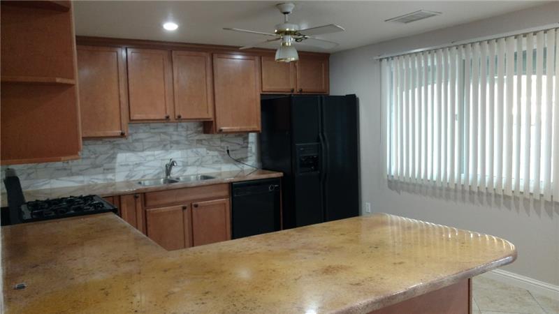 Granite-crete counters, newer cabinets