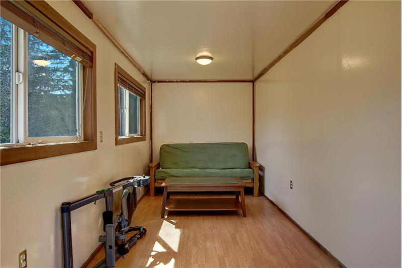 Sellers call this the 'bunk room'; it could be a hobby room, a place to make loud music away from main house, or  more storage.