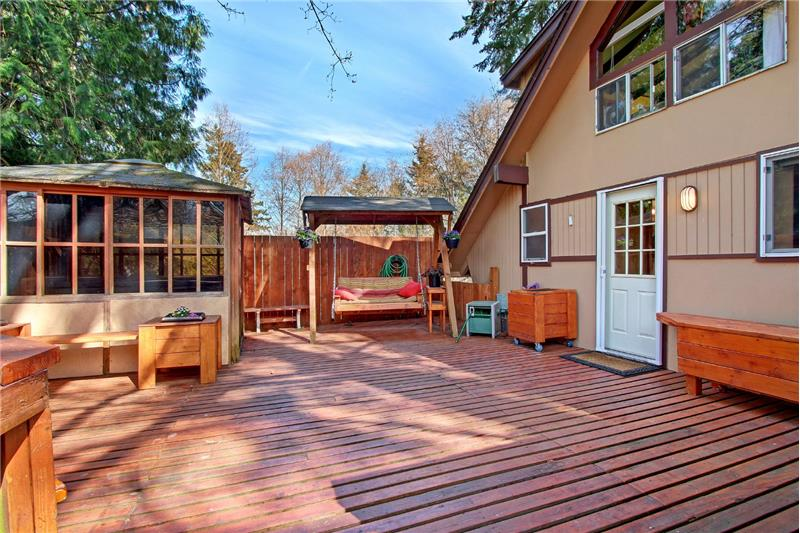 Welcome! Generous decks both front and back. Covered gazebo with hot tub.