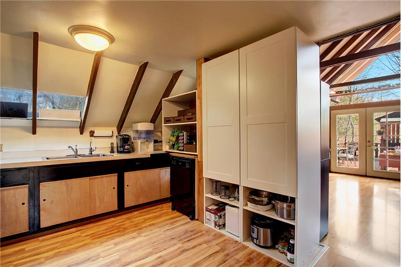 Another look at the kitchen. More soft-close Ikea cabinetry too. Note vaulted ceiling in living & dining areas.