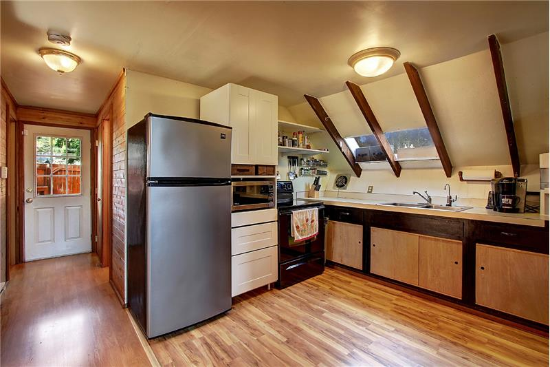 The kitchen offers some soft-close Ikea cabinetry. You are looking back toward the front door.