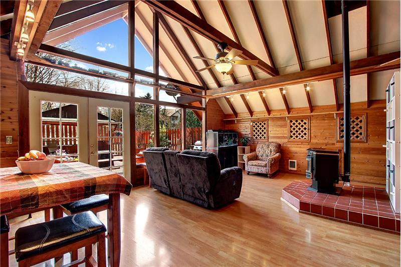 Incredible windows; dramatic vaulted ceilings; exposed beams. Dining area to left. Laminate floors throughout.