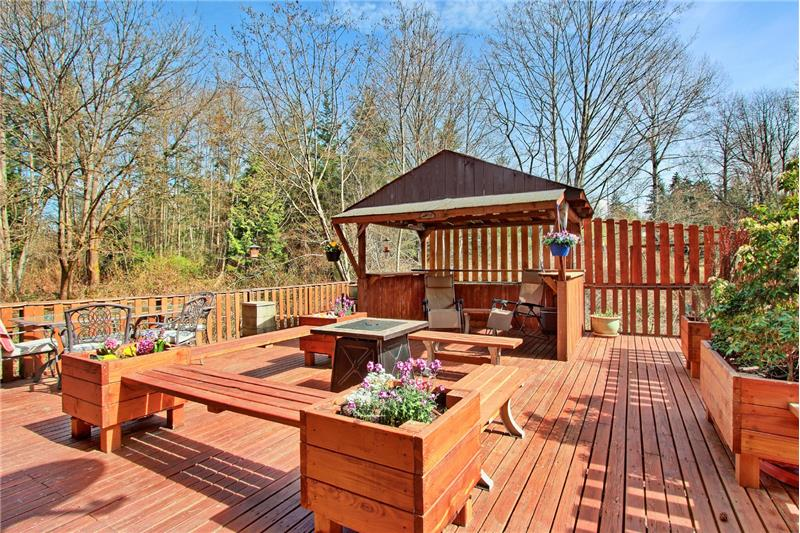 Partially enclosed gazebo space; handy for food prep we are told. Generous seating options. Fire pit when evening cools down.