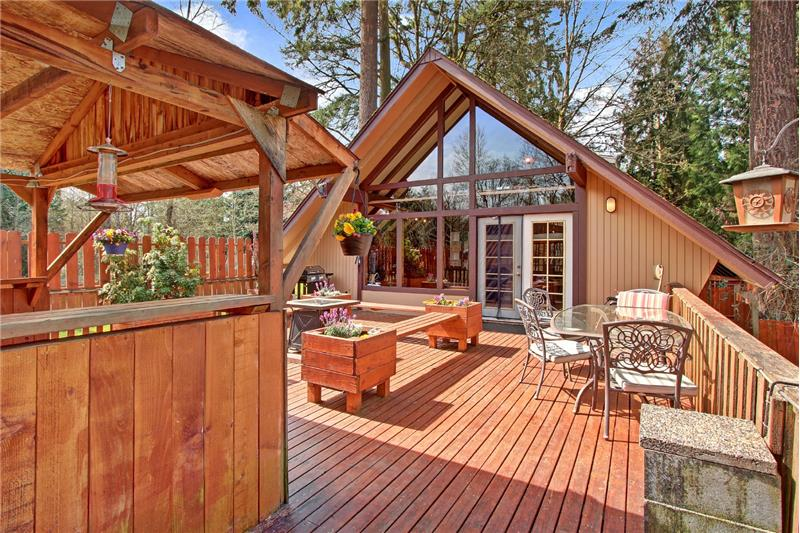 An idyllic outdoor space -- light a fire in the fire pit. A covered food prep space for larger gatherings.