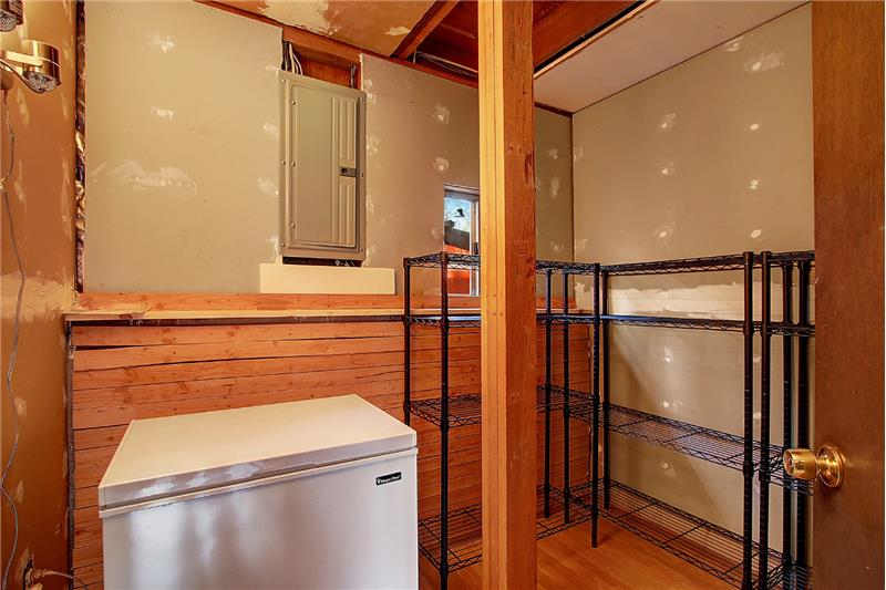 Heated and roughly finished storage space, with a freezer and shelving that stays for your convenience
