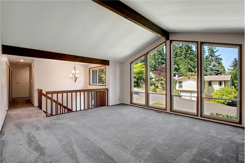 From the living room looking down the hall toward the three bedrooms on this level