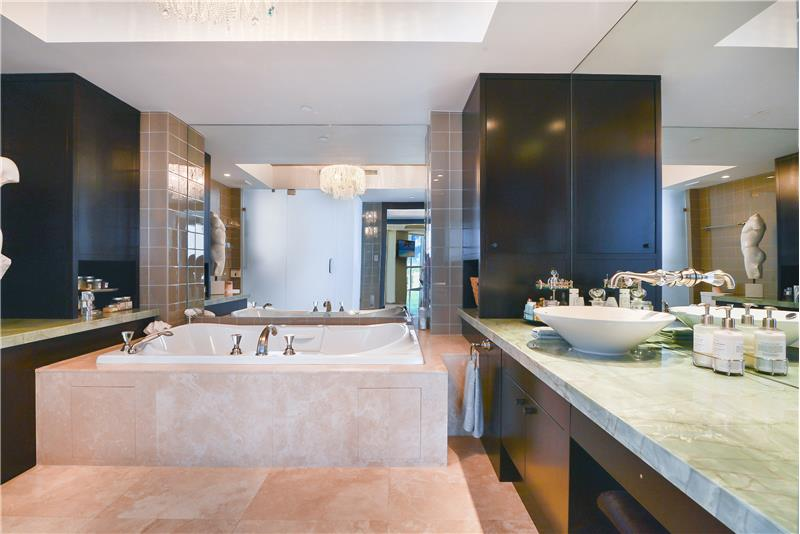 The glamorous master bathroom offers TWO sides as his & hers conveniently connected by the large shower.