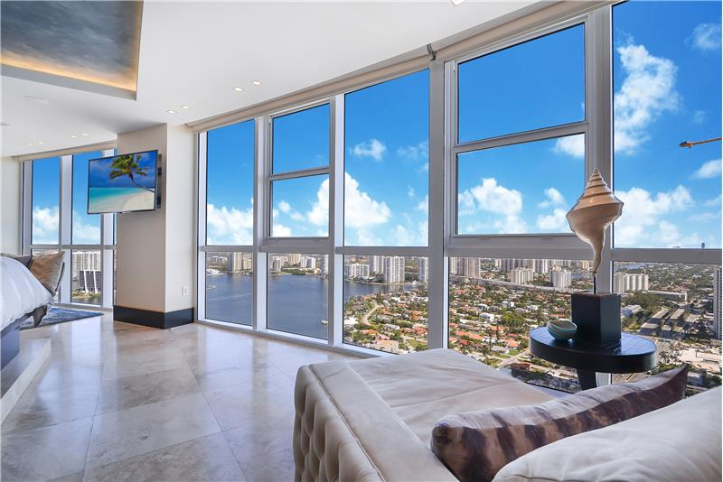 Imagine waking to these views! With two seating areas, the master bedroom is most spacious with views over the Atlantic & City!