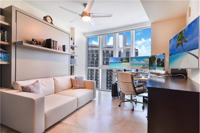 The office doubles as the 3rd bedroom easily converted here with a built-in Murphy bed for guests and desk space.