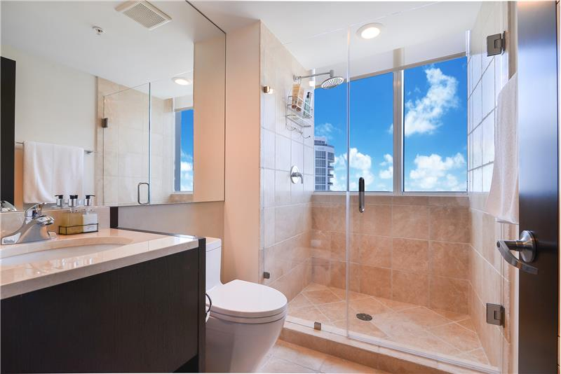 2nd Bedroom private bathroom with amazing views over the City along with natural light pouring in. There are blinds to shade.