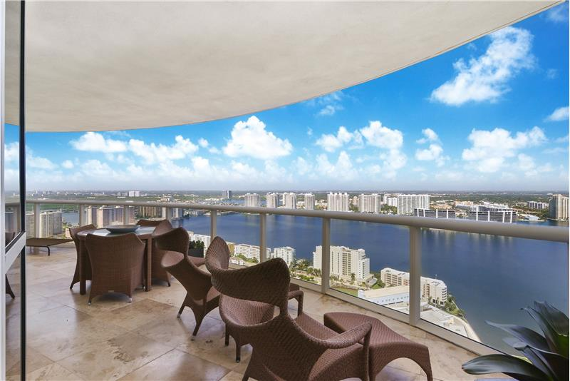 The penthouse level has extraordinary West views from the large terrace over Biscayne Bay and the City.