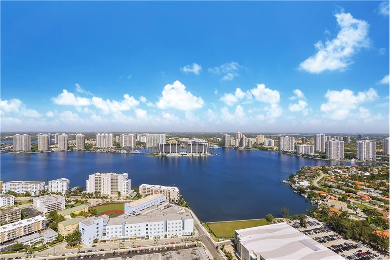West views over the City of Sunny Isles with retail, CVS, shopping, grocery, dining, and an A-Rated school.
