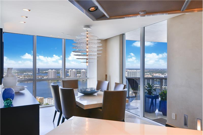 The dining room with open Biscayne Bay views below. A great place to commune with family & friends at any time of the day.