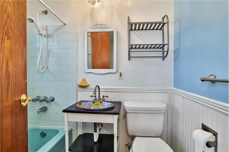 Master bathroom with tub-shower