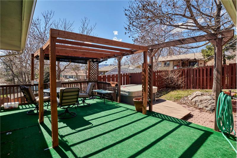 Deck with pergola, with hot tub visible