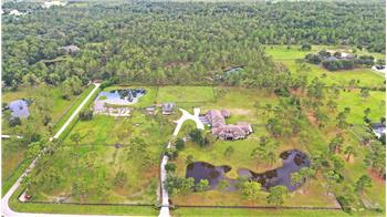 Welcome to Pine Brook Ranch, a 9+ acre luxurious equestrian est...