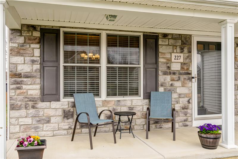 Covered front porch is perfect for greeting neighbors and guests!