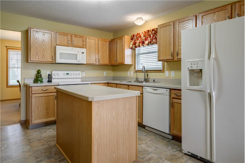 Kitchen includes abundant cabinetry and white appliances!