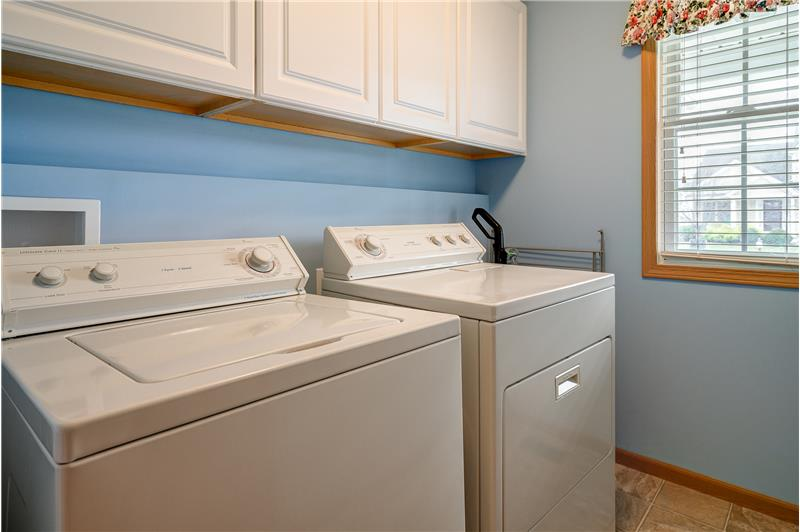 Laundry and cabinetry in the first-floor utility room!