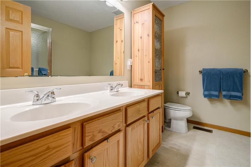 Master bathroom features vinyl flooring and dual sink enclosed vanity!