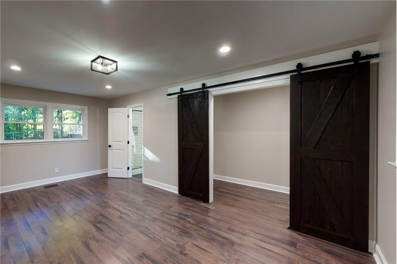 Large main bedroom with sliding barn doors