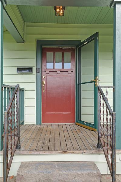 The beautiful and freshly painted front door. (All of the exterior trim on the house has just been repainted.) Welcome!